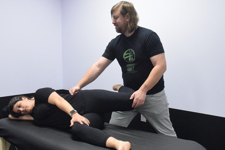 Assisted Stretching at The Trainer's Table